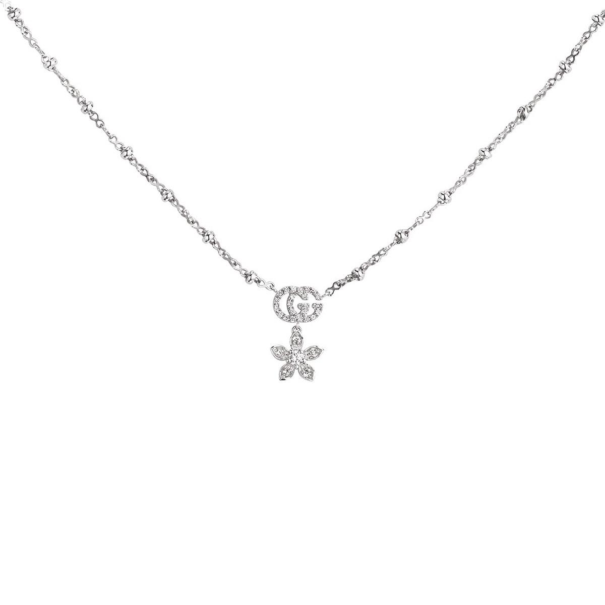 Collana Gucci fiore e Doppia G con diamanti