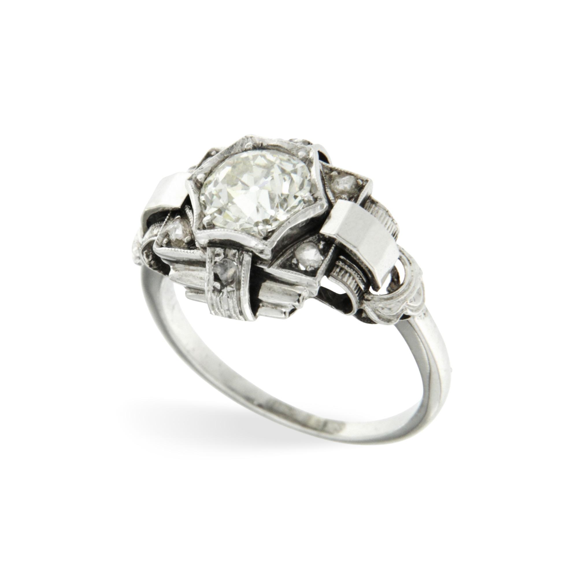 Anello oro bianco con un diamante vecchio taglio